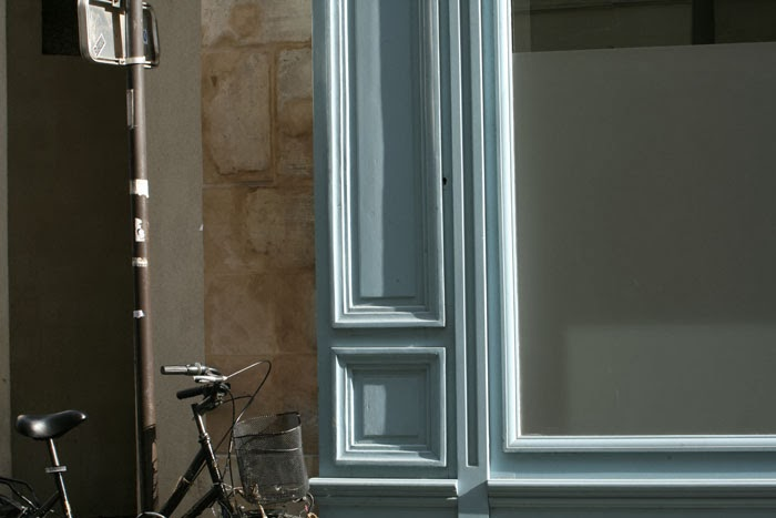 paris bicycle blue wall